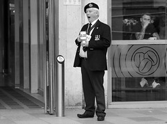 It's been a long day (Just Ard) Tags: street uk urban bw white man black window hat wales photography nikon candid cymru cardiff streetphotography 85mm caerdydd nikkor collector d7000 justard