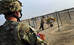 RAF Police Monitoring the Main Entry Point at Camp Bastion, Afghanistan (Defence Images) Tags: uk afghanistan man male military police british op operation fp campaign defense defence raf personnel herrick royalairforce helmand campbastion nonidentifiable