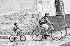 You are being followed (Pejasar) Tags: bw blackandwhite example son father boy guatemala antigua bicycle follow