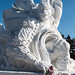 Chinese girl and snow sculpture