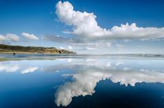 Cloud Lines (Nick Twyford) Tags: blue sea newzealand seascape clouds reflections blacksand nikon wideangle auckland nz northisland westcoast afternoonlight bethellsbeach tehenga colourimage leefilters 1024mm d7000 lee09nd lee06gndhard lee06gndsoft