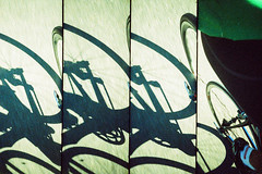 Road bike shadow. (Markus Moning) Tags: road shadow film bike wheel analog 35mm cycling schweiz switzerland lomo xpro supersampler cross sampler kodak rad super x cycle 400 pro process sequence ektachrome processed schatten velo moning rennrad sanktgallen 400x sequenz balgach rennvelo markusmoning gmmeler