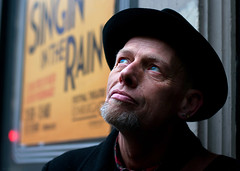 Willie Howard (CSHamilton) Tags: street musician face 50mm eyes artist colours expression glasgow streetportrait citycentre blackhat argylestreet singinintherain characterstudy nikond90 highlandmansumbrella colourstreetportrait glasgowstreetphotog