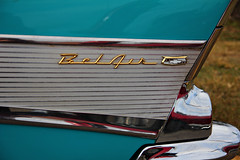 Tailfin (Samantha Evans of Samantha Evans Photography) Tags: red black color reflection classic cars chevrolet belair grass lines car metal canon ga silver reflections georgia gold classiccar automobile paint dof bokeh turquoise painted crest depthoffield chevy bumper chrome badge 1957 fleurdelis plains fin classiccars automobiles tailfin carbadge shallowdepthoffield shallowdof repeatingpatterns chevroletbelair repeatingpattern chevybelair plainsga tamron1750 canon60d oldandbeautiful
