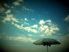 ~ September ~ (Ska * mon) Tags: sky beach clouds nuvole september cielo settembre spiaggia ombrellone
