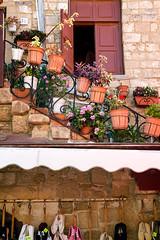 Charming Rhodes (Nomadic Vision Photography) Tags: summer culture greece pottedplants oldtown rhodes shoeshop travelphotography greekisland interestingview jonreid tinareid nomadicvisioncom