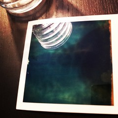 Polaroid ({f}Finn) Tags: wood light reflection glass table polaroid still teal creative moment minimalism magicmoments visualart developing vanagram instagram instagramapp