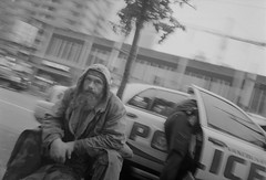 R0021558-1 (Peter?) Tags: christmas street new xmas city people bw white canada black west film westminster station vancouver 35mm shopping cityscape bc waterfront candid 28mm young delta columbia surrey peter 400 shops british gr gastown gr1s ilford ricoh gr1