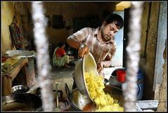 Preparing lunch (Farzana Q.) Tags: street people food kitchen yellow dhaka bangladesh seller 2014