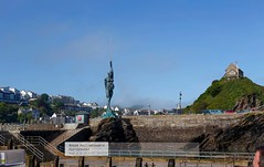 Passengers gorp at the gtotesque statue of the skinned disected pregnant woman as the MS Oldenburg departs Ilfracombe (doublejeopardy) Tags: statue bronze harbour devon ilfracombe damienhirst ixzz32efjnaya