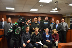 "A group photo of all of the user groups along with ""Paws"" the Pelham Junior B Mascot after all the agreements have been signed"