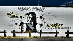 I Love You Baby (Steve Taylor (Photography)) Tags: newzealand christchurch portrait white streetart black love girl smile jessie yellow wall graffiti mural brighton canterbury southisland iloveyou carpark newbrighton merryxmas