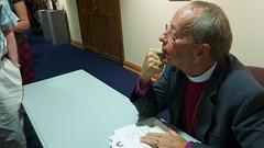 Bishop Robinson signing books