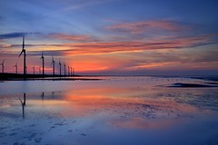 Kaomei Wetland (Vincent_Ting) Tags: sunset sea sky reflection beach water windmill silhouette clouds seaside taiwan  formosa   windturbine crepuscularrays wetland               colorfulbeach vincentting