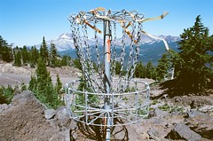 Disc Golf (IggyRox) Tags: trees sky usa mountains nature rock oregon volcano basket view wind cascades pacificnorthwest discgolf volcanic brokentop frisbeegolf mountbachelor deschutescounty almostanything lavalaunch