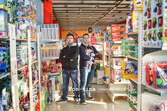Two young italian  entrepreneurs in their toy shop - Cartigliano -  Vicenza -Italy (Fon-tina) Tags: people italy smiling horizontal retail standing toy photography holding day content happiness persone indoors fotografia youngadult selling twopeople blackhair toyshop variation adultsonly vicenza frontview confidence giorno veneto sorridere twomen casualclothing contento tenere smallbusiness giocattolo waistup vendere mezzobusto abbigliamentocasual variet capellineri cartigliano negoziodigiocattoli venditaaldettaglio italiaeurope 2024years piccolaimpresa stareinpiedi ambientazioneinterna soltantounapersona solounadonnagiovane solounadonna soloadulti puntodivistafrontale composizioneorizzontale sicurezzadis 2024anni giovaniadulti