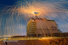steel wool in Saigon (Andy Le | +84908231181) Tags: city man wool skyline night circle fire steel rotating saigon builiding