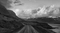 driving through all kinds of weather (lunaryuna) Tags: iceland northwesticeland westfjords road ontheroad travel journey voyage microclimate microweather fjord coast landscape seascape mountainrange sky clouds cloudscape weathermood lunaryuna nature blackwhite bw monochrome spring season seasonalbeauty