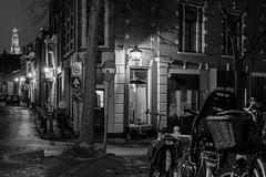 After Dark (McQuaide Photography) Tags: haarlem noordholland northholland netherlands nederland holland dutch europe sony a7rii ilce7rm2 alpha mirrorless 55mm primelens prime sonnar sonyzeiss zeiss fe55mmf18za fullframe mcquaidephotography adobe photoshop lightroom tripod manfrotto light licht availablelight night nacht nightphotography longexposure stad city urban straat lowlight outdoor outside house residential huis huizen building gebouw winter emptystreet nopeople burgwal bike bicycle fiets fietsen corner hoek streetcorner churchspire grotekerk stbavo blackandwhite blackwhite bw mono monochrome