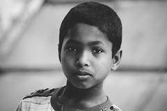 Eyes... (Sheikh Shahriar Ahmed) Tags: street portrait bw kid dhaka bangladesh childportrait kidportrait dhakadivision sheikhshahriarahmed