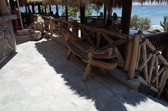 Crocodile Carving Beach Bar Kos (Michael Blacktom) Tags: wood sea sun seascape beach restaurant bokeh alligator kos carving greece crocodile ricoh ricohgr carvings woodcarving seaview crocodiles beachbar