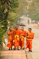 happy (Karl_78) Tags: street orange boys smiling umbrella walking happy monks laos luang prabang