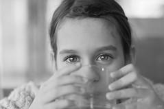 in your eyes (idni . idniama) Tags: blancoynegro luz girl 50mm gris blackwhite nikon bokeh drinking brighteyes gettyimages inyoureyes 2013 idni gettyimagesiberiaq3