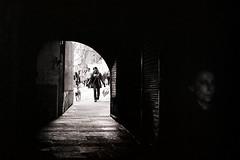 Street shot (III) (A.González) Tags: city blackandwhite bw woman blancoynegro film blanco girl angel contrast contraluz calle puerta nikon women alone fear entrance ciudad bn galicia galiza contraste entrada caminar anciana miedo vigo fm2 caminando 18105 femmale temor callejera fotocallejera fm2n galician callejear angelgonzalez fotografíacallejera agiz3