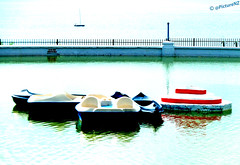 The Boating Pool on the Royal Esplanade in Ramsgate (Steve Taylor (Photography)) Tags: uk greatbritain blue red sea england white lake black reflection green english water pool fence island boat kent kayak unitedkingdom yacht britain paddle canoe boating british railing ramsgate thanet royalesplanade vision:text=0594 vision:car=0812 vision:outdoor=0641