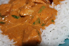 Thai red curry served with boiled rice and garnished with grated coconut (WorldClick) Tags: china red chicken leaves canon eos ginger photo flickr photographer with rice coconut cinnamon salt curry powder fresh photograph thai garlic served lime chilli lemongrass coriander cumin boiled kaffir garnished phototgraphy dhaniya 1100d canoneos1100d thairedcurryservedwithboiledrice worldclick