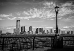 Crossing Hudson (Anthony P26) Tags: category citiestowns newyork places travel usa cityscape skyline sky clouds fence lamp light bluesky river hudsonriver jersey buildings modernbuildings waves monochrome blackandwhite whiteandblack bw outdoor glass steel whiteclouds park batterypark canon550d canon1585mm canon