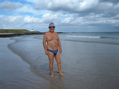 Paddling at Bamburgh (pj's memories) Tags: lighthouse beach sunglasses seaside northumbria trunks bathing bamburgh sunhat tanthru kiniki