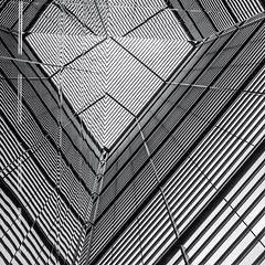 Enter Light At More London Place I (Mabry Campbell) Tags: uk windows england blackandwhite abstract london monochrome lines june photography photo europe pattern photographer image unitedkingdom capitol photograph 100 24mm f71 squarecrop fineartphotography architecturalphotography capitolcity commercialphotography fav10 2013 architecturephotography vertcal tse24mmf35l fineartphotographer houstonphotographer ¹⁄₄₀₀sec mabrycampbell june102013 201306100h6a3644