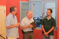 Ian McCarthy and Roger Stanton present a plaque to Giuseppe Millozzi at Casa della Memoria