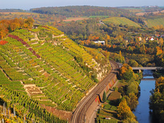 Vineyard Terraces above the Wine Route (Wrttemberger Weinstrae) (Batikart) Tags: road bridge blue autumn trees houses sky plants green fall nature water lines canon reflections river germany way landscape geotagged deutschland vineyard flora wasser europa europe pattern view riverside natur