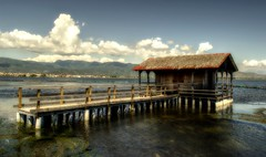 """""""Once a year, go someplace youve never been before.  Dalai Lama (Peony71) Tags: clouds pier lagoon woodenbridge woodenpier woodenhut mesologhi  nikond3100 fishermenscabin"""