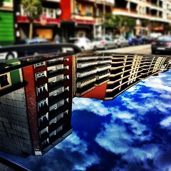 Sobre el techo de un coche... (Asturiphone) Tags: reflection clouds mirror streetphoto gijon reflejos uploaded:by=flickstagram victormsuarez instagram:venue_name=avenidadepabloiglesias instagram:venue=13726360 instagram:photo=1883759556141695518026757