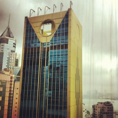 #building #reflection #hongkong #causewaybay (shinyo_02) Tags: square squareformat earlybird iphoneography instagramapp uploaded:by=instagram foursquare:venue=4ec221560aaf6450bbb8c9b1