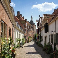 The Muurhuizen have come to be a symbol of Amersfoort (Bn) Tags: old city holland tower history ford monument netherlands wall architecture buildings river topf50 day symbol tourist medieval ring well national zomer preserved innercity middle topf100 idyllic nederlands ages defense centrum amersfoort watchtower amer muur defend waterpoort stokrozen muurhuizen onzelievevrouwetoren koppelpoort binnenstad historische kamperbinnenpoort stadsmuur 100faves 50faves plompetoren innergate landpoort wallhouses verdedigingswerk dieventoren pwpartlycloudy amersfortia