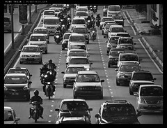 _5015571bw copy (mingthein) Tags: life street morning people blackandwhite bw cars monochrome four traffic availablelight streetphotography photojournalism peak olympus rush hour micro malaysia pj kuala jam kl ming lumpur 43 omd reportage thirds m43 onn mft em5 thein photohorologer micro43 microfourthirds mingtheincom