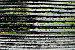 Park Bench in the Rain (5) (A-Lister Photography) Tags: park uk light england black london wet water lines rain weather horizontal landscape seat raindrops parkbench waterdrops raining heavyrain wetreflections adamlister nikond5100 alisterphotography