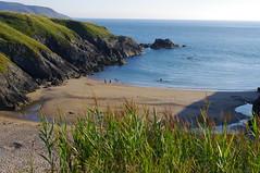 Iago (Tragopodaros) Tags: sea summer beach nature wales bay coast seaside sand holidays cove august bluesky calm cliffs coastline grasses bluesea calmsea porthiago wildcoast lleynpeninsula