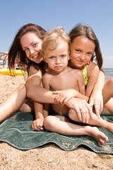Young mom with kids at the beach resort (theater.eater) Tags: ocean family sea summer vacation woman holiday hot beach water girl beautiful beauty weather smiling kids lady female children mom happy togetherness seaside kid sand pretty european adult bright sister brother mommy daughter young mother happiness son mama resort chick mum enjoy attractive leisure summertime positive care relaxation swimsuit caucasian