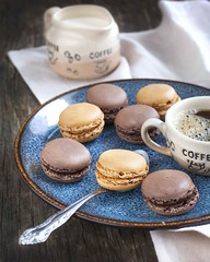 French macaroons.  Coffee and chocolate macarons (Anjelagr) Tags: food brown france color cup coffee cookies french table dessert cuisine cafe flavor sweet handmade chocolate background traditional cream plate spoon gourmet delicious bakery snack assortment stacked confectionery gastronomy confection macaroons macaron