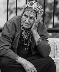 Today's adolescents are disgusting! (ybiberman) Tags: israel jerusalem alquds oldcity muslimquarter woman old veil gaze wrinkles candid streetphotography