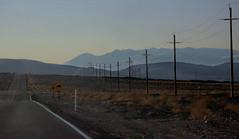 Row of Poles (lefeber) Tags: california road mountains landscape morninglight vanishingpoint haze desert perspective roadtrip powerlines valley hazy telephonepoles owensvalley atmosphericperspective aerialperspective sierranevadamountains
