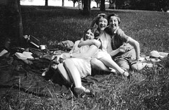 Happy girlfriends enjoying a picnic 20s (vintage ladies) Tags: ladies girls friends people blackandwhite woman cup girl beauty smile hat smiling lady laughing vintage women picnic pretty dress legs smiles dresses laugh cuddle lovely girlfriends 20s 20slady 20sladies