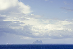 Omnious clouds over the Rock (FreakyLeo) Tags: ocean africa sea water rock spain europe mediterranean ship gib atlantic gibraltar straits tanker ceuta pentaxk5 pentaxda70mm124limited