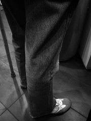 The half standing. (Pranil.Raja) Tags: life detail standing dark blackwhite moving moody walk story queue stick emotional disability depiction