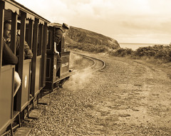 Driving Us Round the Bend (The_Kevster) Tags: leica sea sky people heritage monochrome sepia clouds train vintage seaside tracks railway rangefinder tourists cliffs steam locomotive mann curve isleofman manx steamtrain sleepers onchan carriages summicron50mm ellanvannin leicam9 groudleglenrailway